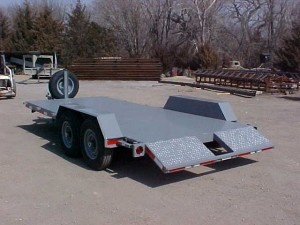 Short Dove Tail – 2-3' Ramps with hidden carriers under the trailer. Spare tire and brakes on both axles.